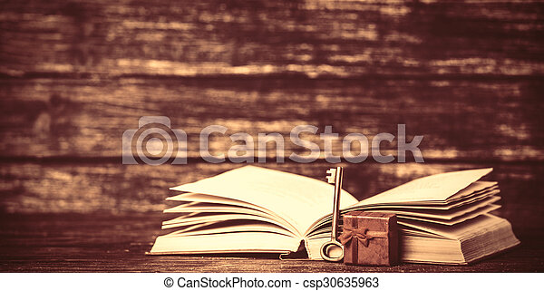 Present box and open book.