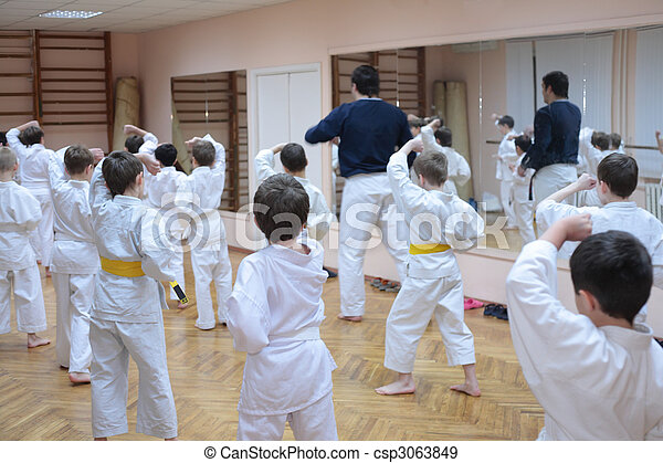 karate boys training in sport hall - csp3063849