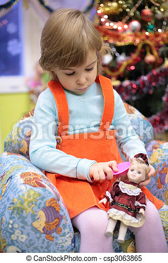 girl in kindergarten with doll - csp3063865