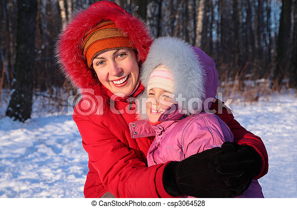Mother embraces daughter in park in winter - csp3064528
