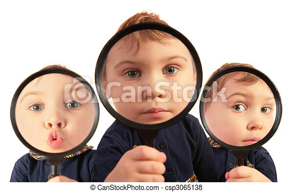 Children looking through magnifiers collage - csp3065138