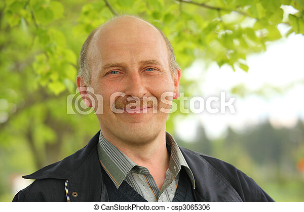 middle-aged man in the summer park - csp3065306