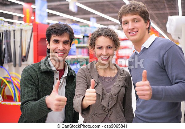 Three friends make gesture ok  in shop - csp3065841