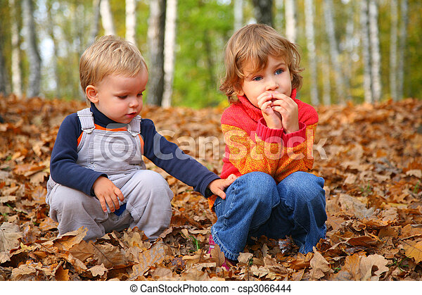 sister with brother children in autumn park - csp3066444