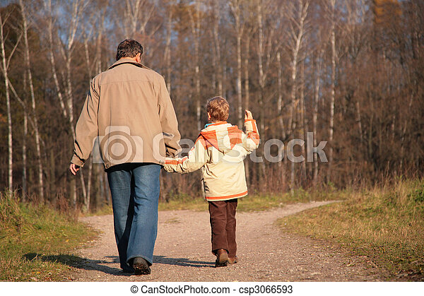 Grandfather and the grandson walk on wood, keeping for hands - csp3066593