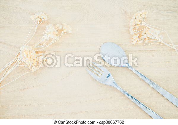 Fork and spoon on wood texture background