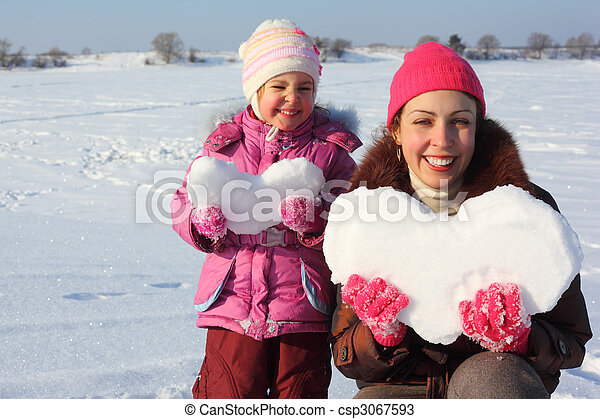 Little girl and mother with snowy hearts - csp3067593