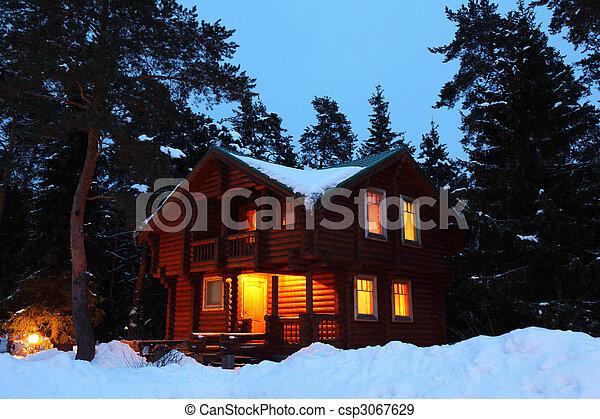 wooden house in winter wood in twilight - csp3067629