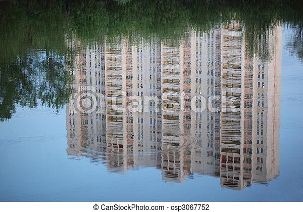 Skyscraper reflexion in water - csp3067752