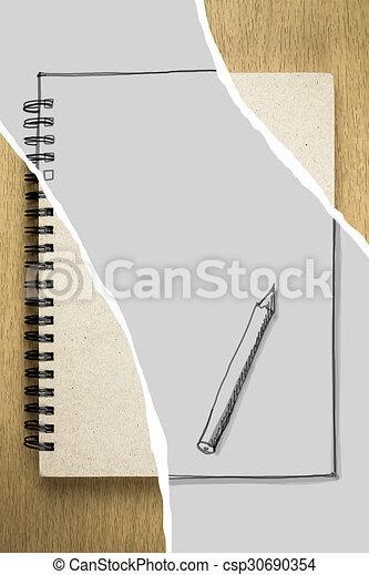 brown notebook or sketchbook on wooden table