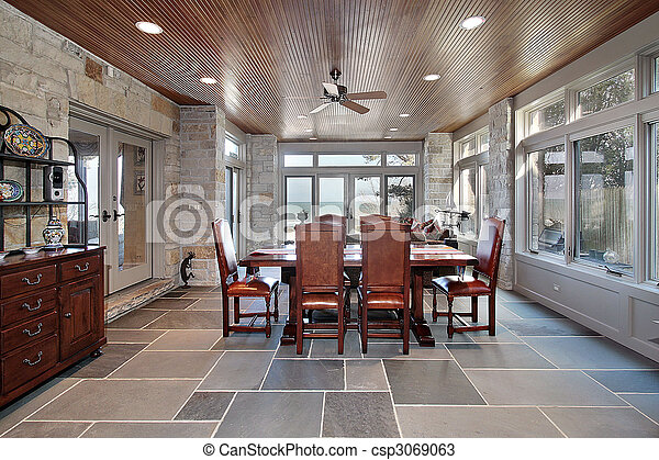 Porch with stone walls and slate floors - csp3069063