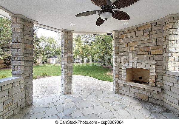 photo de pierre couvert patio nouveau construction maison csp3069064 recherchez des. Black Bedroom Furniture Sets. Home Design Ideas