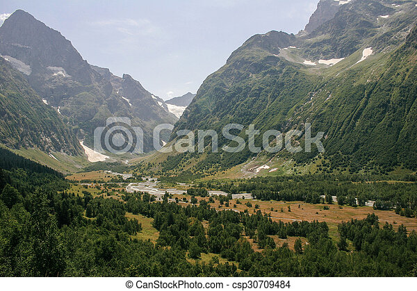 Mountain Valley, a top view of the river bed.Landscape with a mountain river. Landscape with mountains trees and a river