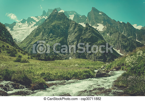 Mountain Valley, a top view of the river bed. Landscape with a mountain river. Landscape with mountains trees and a river
