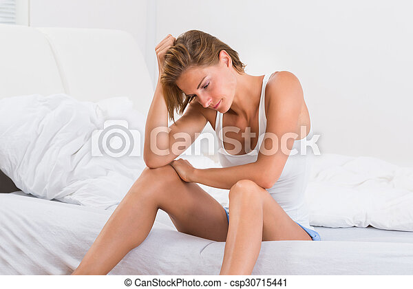 Young Woman Sitting On Bed - csp30715441