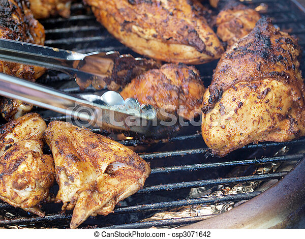 bar-b-que chicken on the grill with tongs - csp3071642