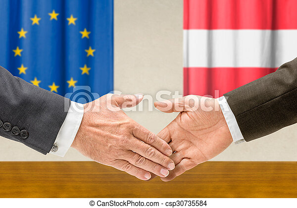 Representatives of the EU and Austria shake hands