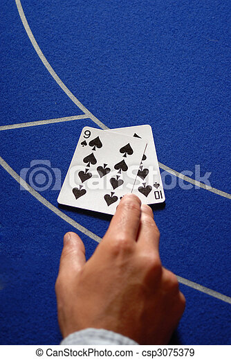 Two cards in hand on a Casino table - csp3075379