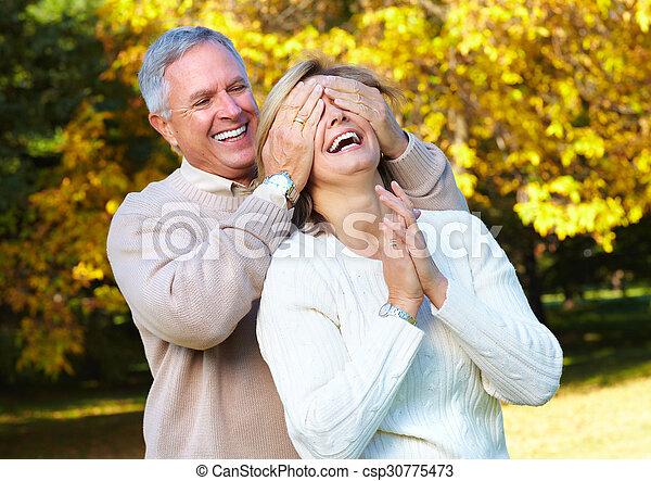 Happy senior couple in park. - csp30775473