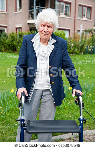 Elderly woman with walker - csp3078549