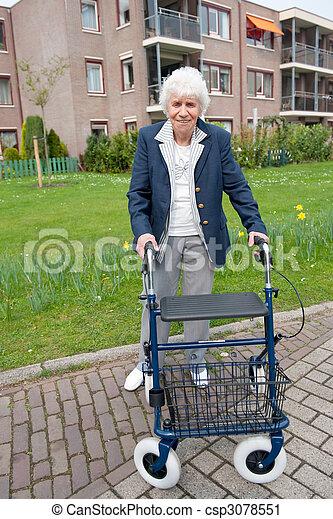 Elderly woman with walker - csp3078551