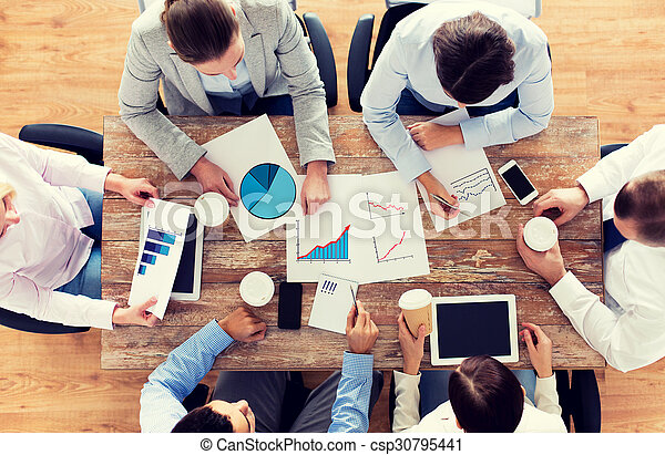 close up of business team with coffee and papers