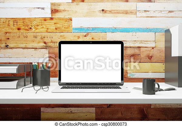 Mock up of blank laptop on the desk