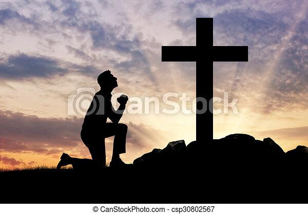 Silhouette of man praying