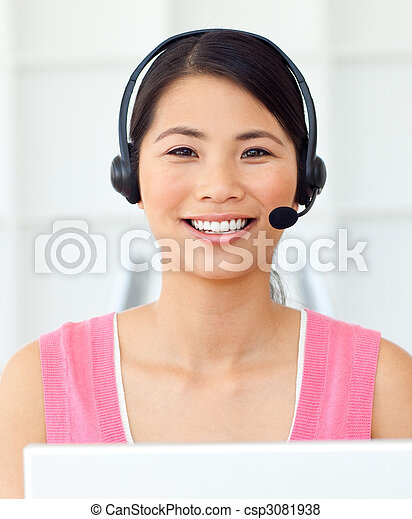 Cheerful businesswoman using headset in a call center - csp3081938
