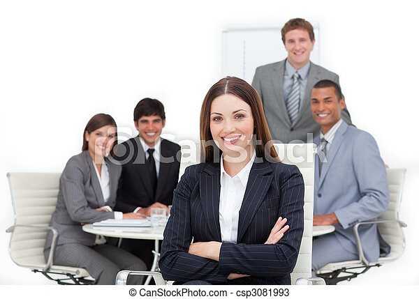 Charismatic female executive sitting in front of her team - csp3081993