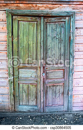 Old door painte in green and blue color, weathered architectural detail in Astrakhan, Russia