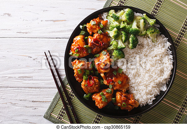 Asian chicken with rice, onions and broccoli. Horizontal top view
