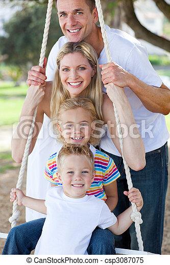 Jolly family swinging  - csp3087075