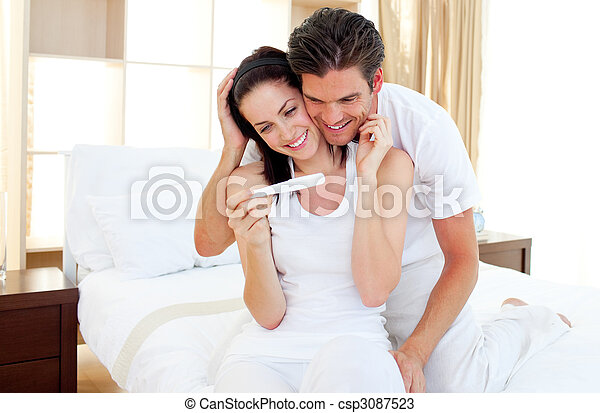 Enamoured couple finding out results of a pregnancy test - csp3087523