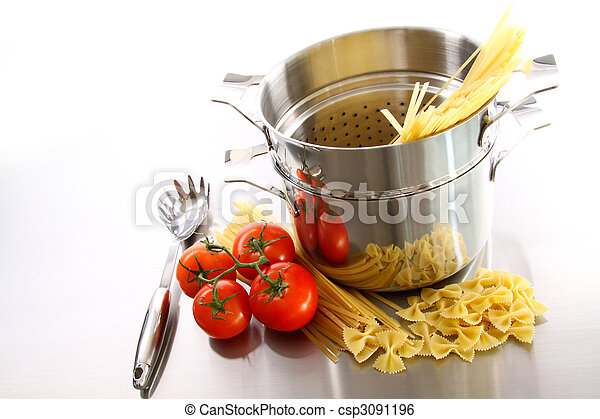 Cooking pot with uncooked pasta and tomatoes - csp3091196