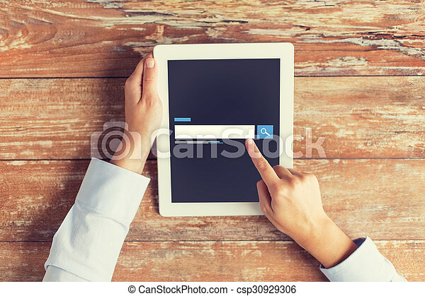 close up of male hands using browser on tablet pc