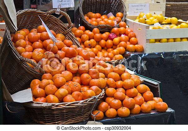 Fresh oranges in baskets at a fruit market