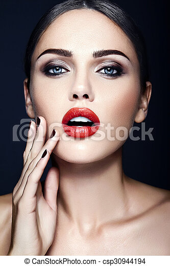 sensual glamour portrait of beautiful woman model lady with fresh daily makeup with red lips color and clean healthy skin face