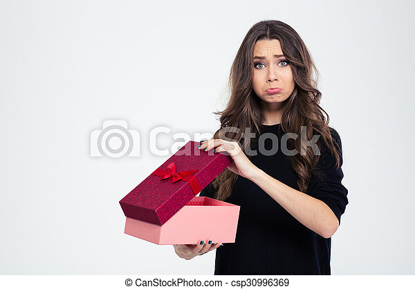 Sad woman standing with opened gift box