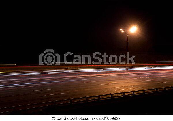 street lamp on highway at night