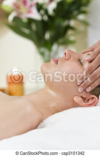 Woman Having Relaxing Head Massage At Health Spa - csp3101342