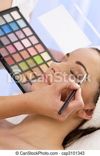 Beautiful Woman Having Make Up Applied by Beautician at Spa - csp3101343