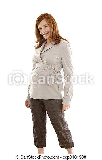 Pregnant woman fashion redhead portrait - csp3101388