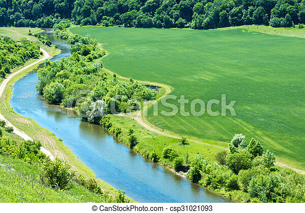 Landscape of river and green wheat field