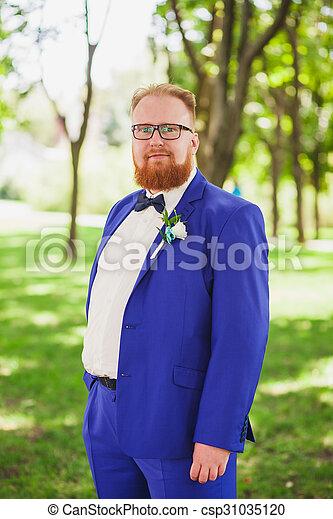 cheerful groom at the wedding