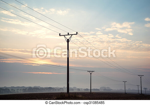 sunrise sky over power lines