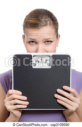 afraid young woman looking behind a weight scale - csp3109590