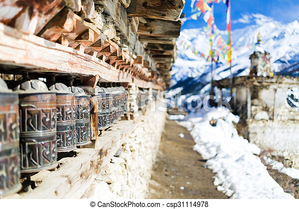 Prayer wheels in high Himalaya Mountains, Nepal village. Annapurna Two range region in Nepal, located at Annapurna Circuit Trekking Hiking Trail
