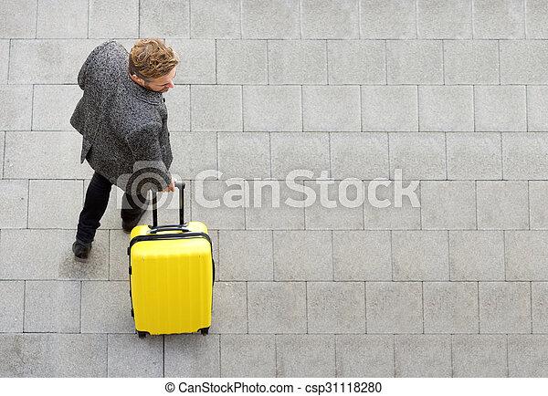 Travel man walking with suitcase
