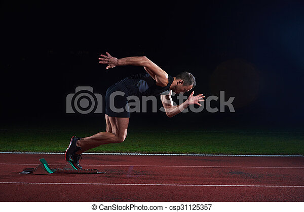 Sprinter leaving starting blocks - csp31125357
